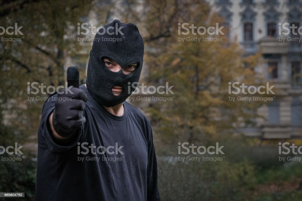 Unrecognizable masked man showing thumbs up gesture. Outdoors - fotografia de stock