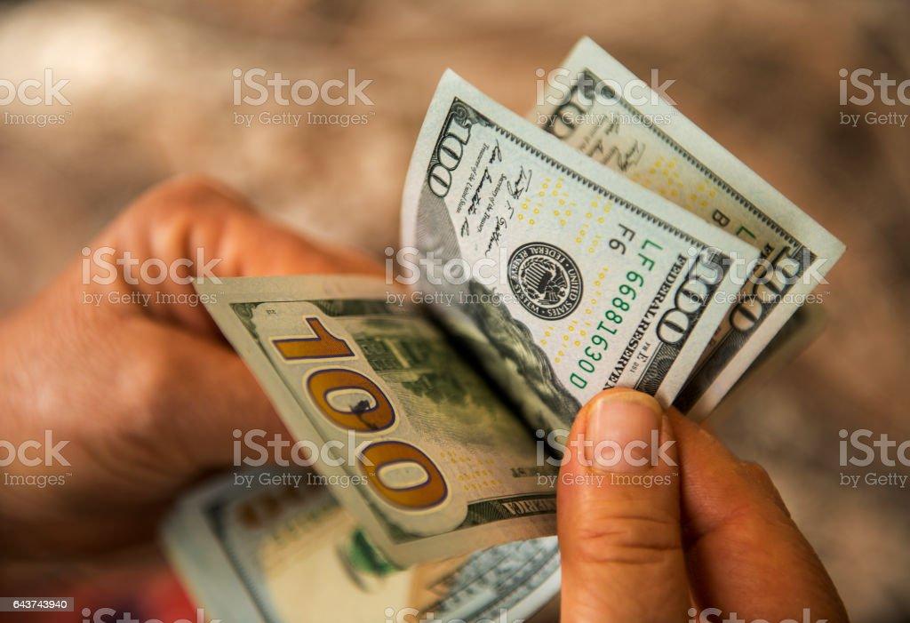 Unrecognizable mature man counting USA Dollar bills stock photo