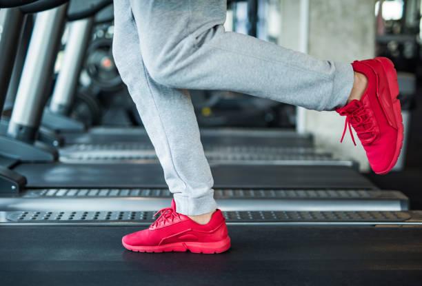 unrecognizable mature man running on a treadmill. - runner rehab gym foto e immagini stock