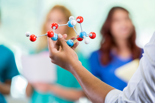 istock Unrecognizable medical school professor teaches about molecular structure 866255388