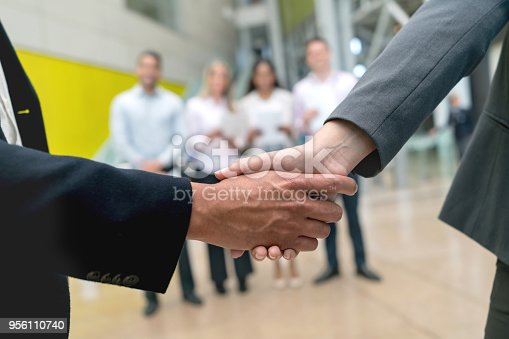istock Unrecognizable people ending a successful business agreement handshaking 956110740