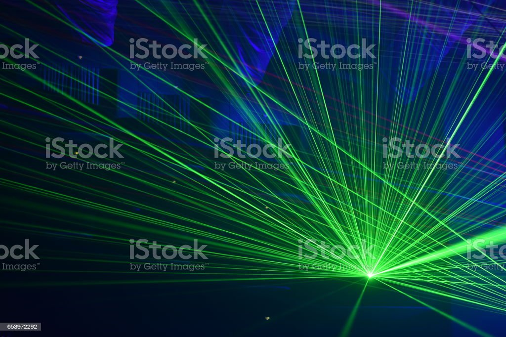 Unrecognizable people watching a beautiful laser show stock photo