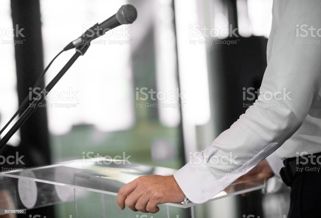 Unrecognizable person giving speech at awards ceremony stock photo