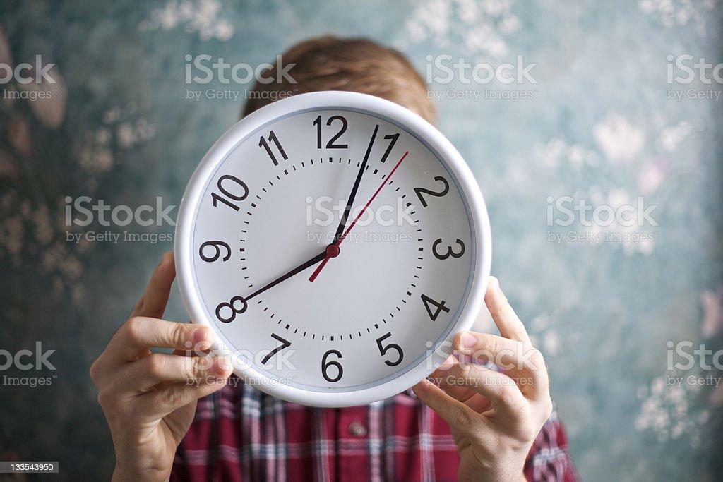 Unrecognizable Person Holding a Clock stock photo
