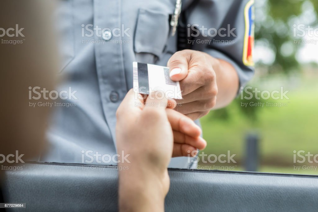Unrecognizable person is pulled over for speeding stock photo