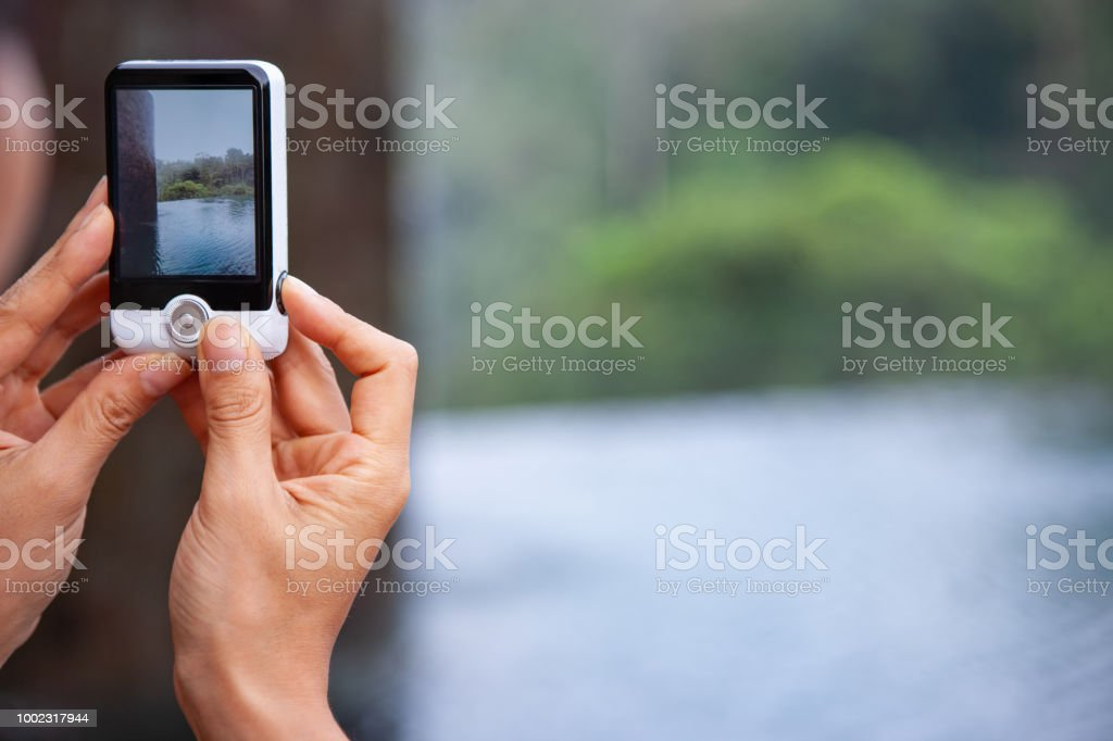 Unrecognizable person taking photos on vacation