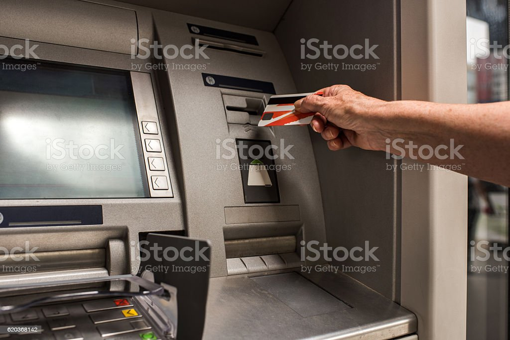 Unrecognizable person with a credit card on ATM. zbiór zdjęć royalty-free