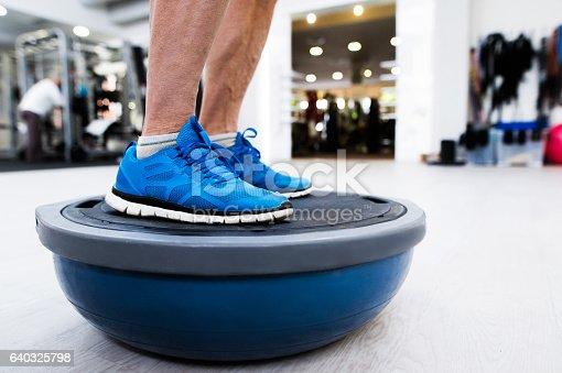 istock Unrecognizable senior man in gym standing on bosu balance ball 640325798