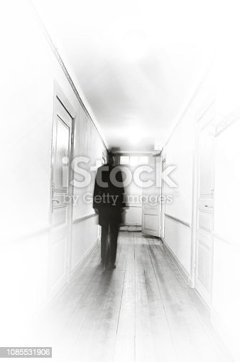 istock Unrecognizable silhouette of man in blurred motion 1085531906