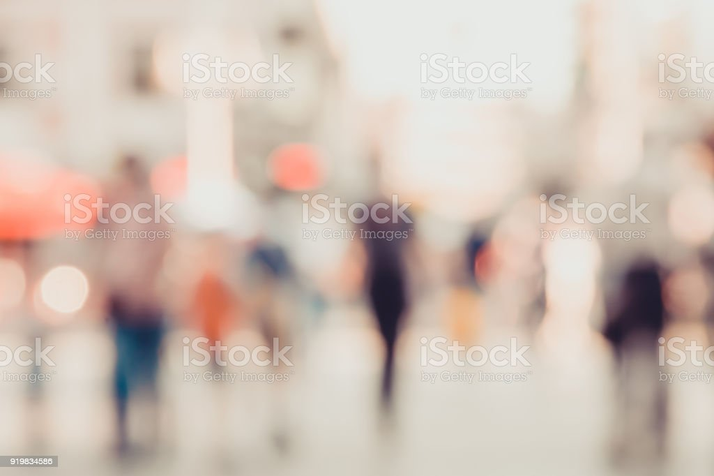 unrecognizable silhouettes of people walking on a street stock photo
