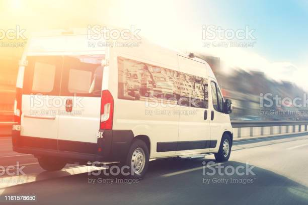 Unrecognizable small passenger van hurry up on highway at city street picture id1161578650?b=1&k=6&m=1161578650&s=612x612&h=pdn6elgfm2hvx1rl5w77b2bh6qct32hlop9b7wpppga=
