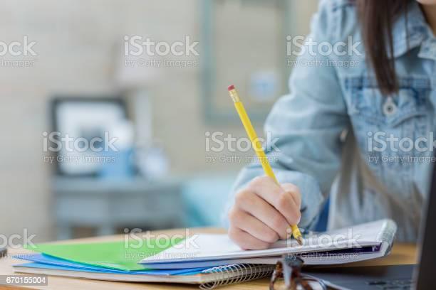 Unrecognizable student works on homework assignment picture id670155004?b=1&k=6&m=670155004&s=612x612&h=awm4pwxwzlufp tla 7eivad8zarhziaicvkie94eqo=