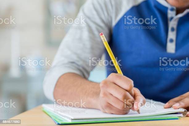 Unrecognizable student works on homework assignment picture id684677680?b=1&k=6&m=684677680&s=612x612&h=6wr9ani fusezhcf1ivo nwczbdiuoybk2qdhr6ppmg=