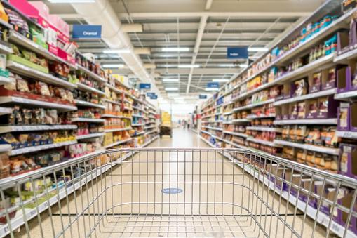 Unrecognizable supermarket aisle as background