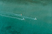 unrecognizable windsurfer from high drone angle