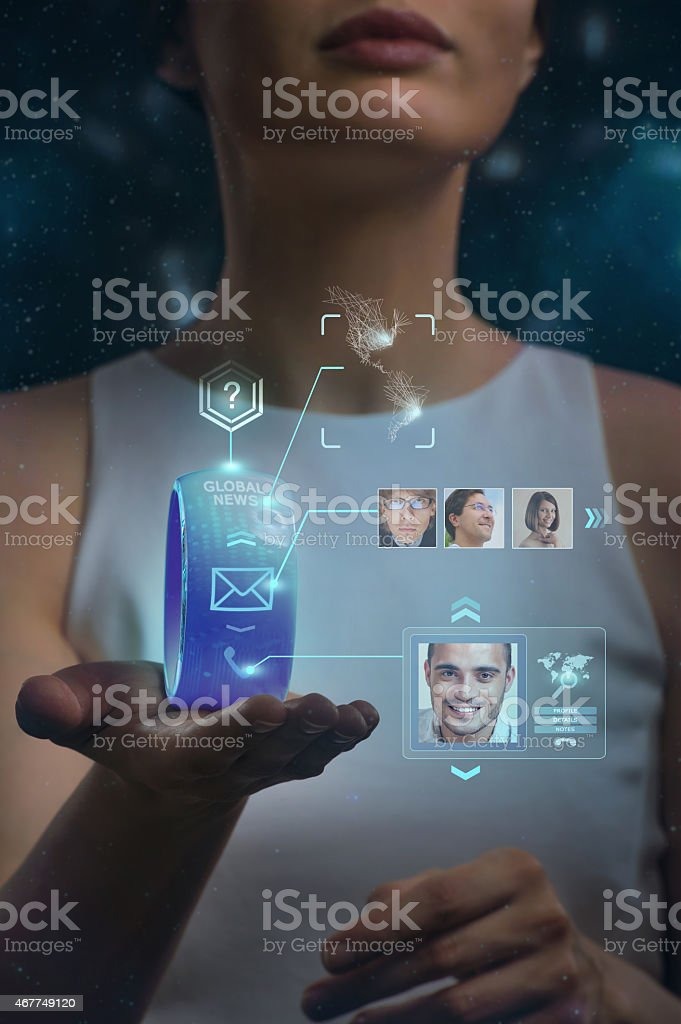 Unrecognizable woman holding wearable gadget. New technologies. stock photo