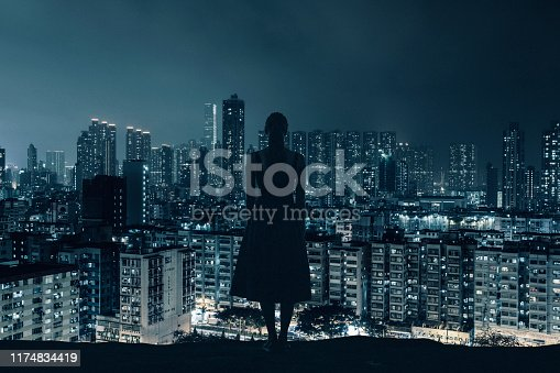 Concept image: young unrecognizable woman looking at futuristic city.