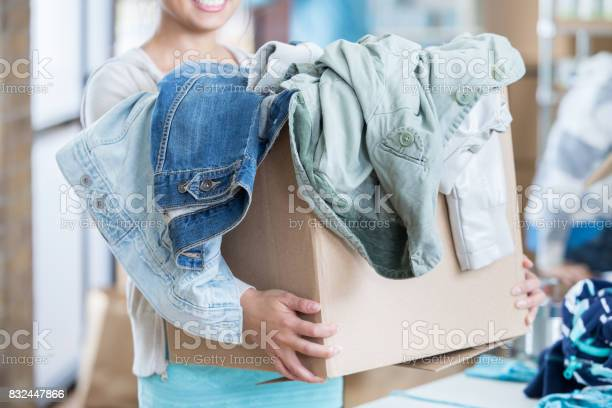 Unrecognizable woman receives box of clothing during clothing drive picture id832447866?b=1&k=6&m=832447866&s=612x612&h=qpwx 4pkhq7h1hcc9k1rbkt2stmxds57qhwztj36die=