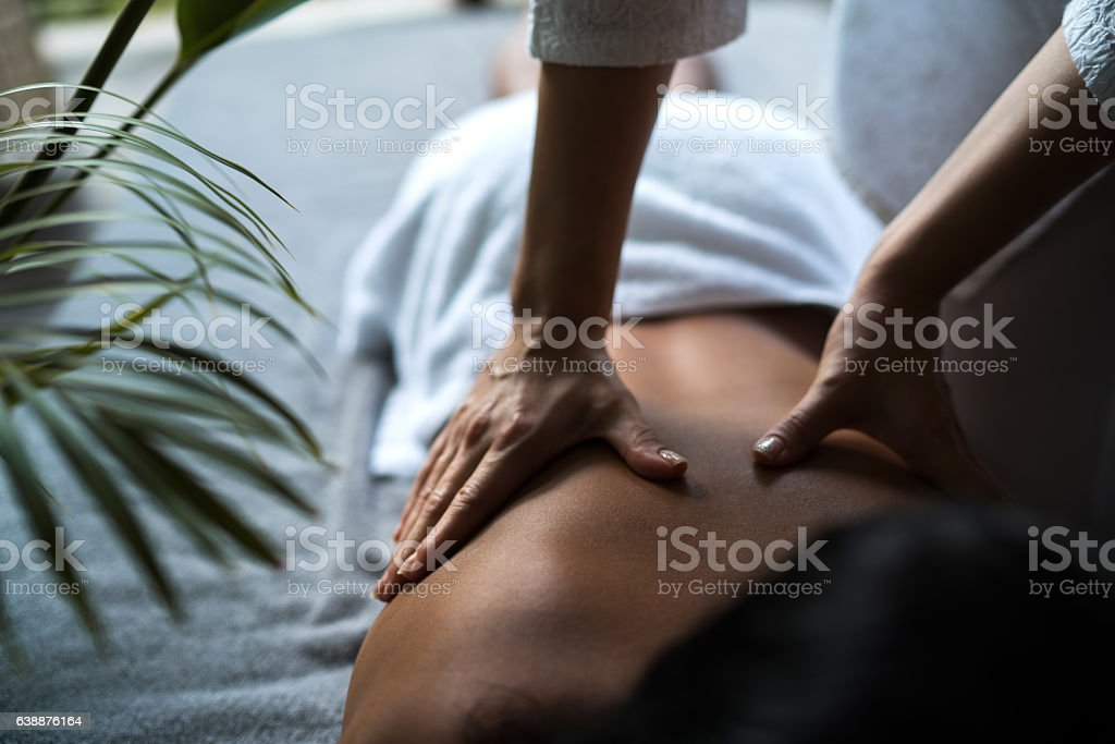 Unrecognizable woman receiving back massage at the spa. stock photo