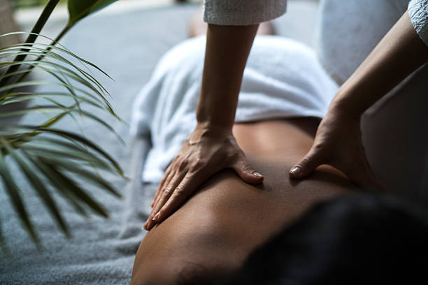 Unrecognizable woman receiving back massage at the spa. - foto de acervo