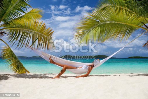 Caribbean Relaxation: Unrecognizable Woman Relaxing In A Hammock At The