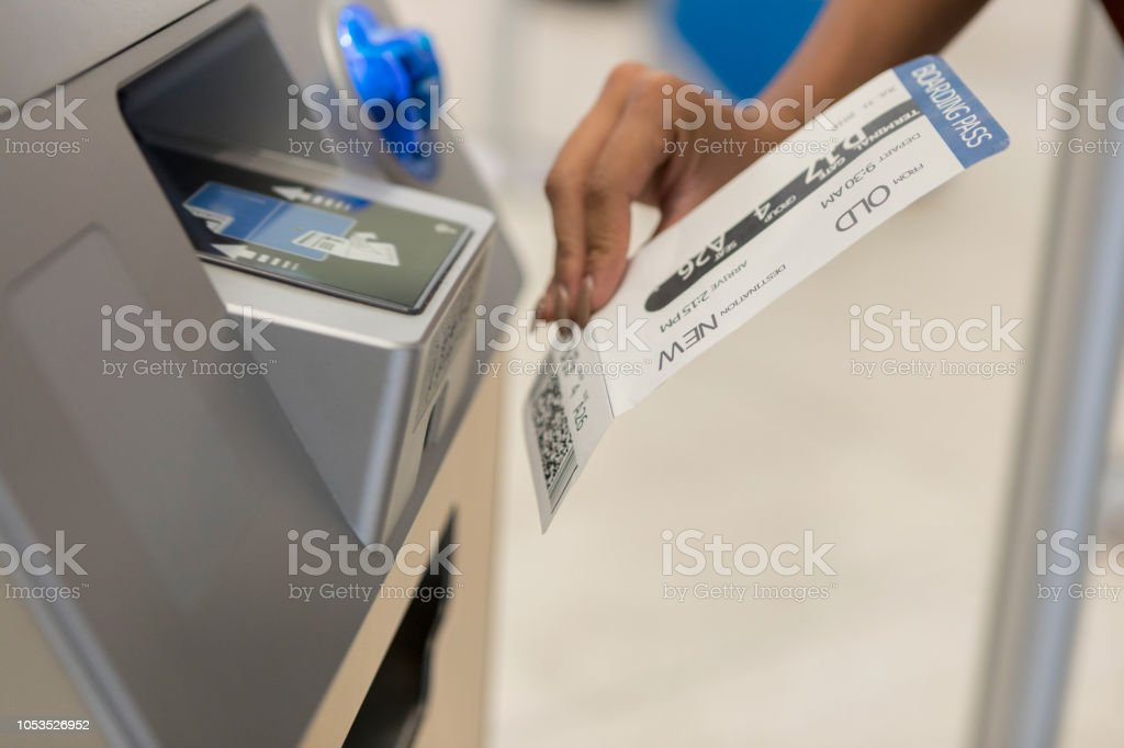 Unrecognizable Woman Scans Boarding Pass At Airport Kiosk Stock
