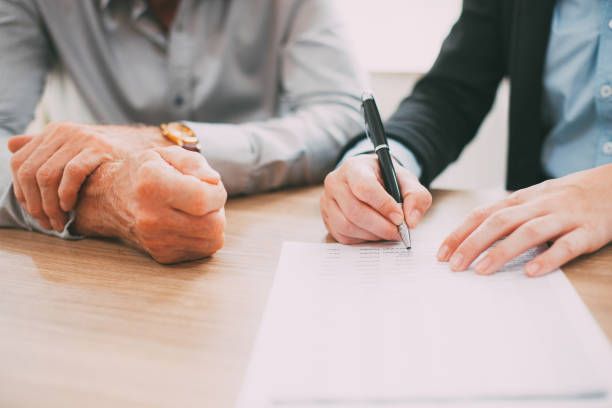 Unrecognizable woman signing contract at meeting_tone stock photo