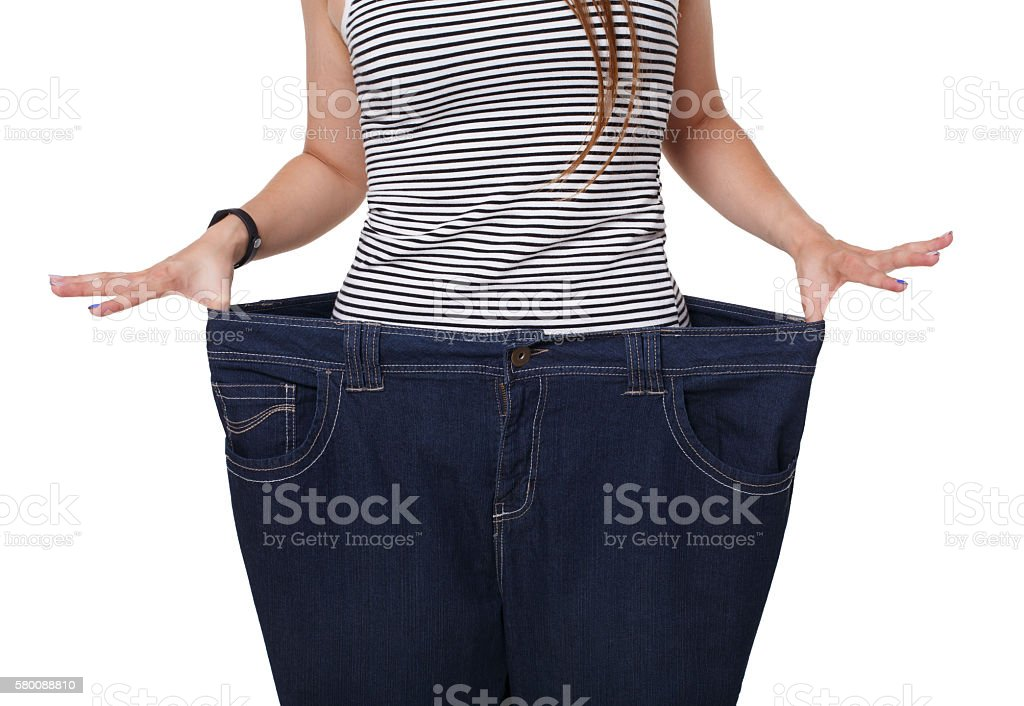 Unrecognizable woman torso, showing diet results isolated on white stock photo