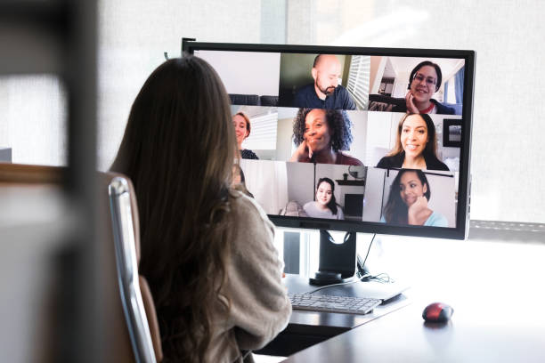 Unrecognizable woman video conferences from her office stock photo