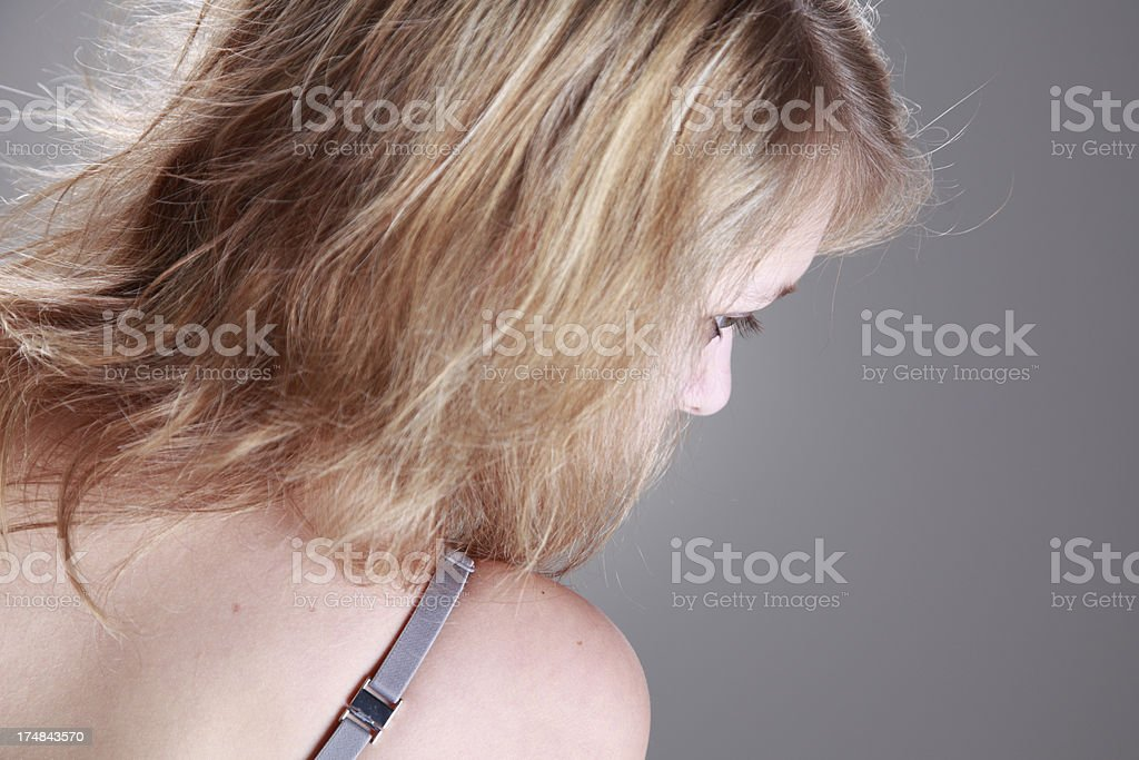Unrecognizable woman with bra from behind royalty-free stock photo
