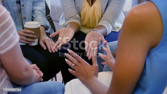 1055095320 istock photo Unrecognizable women gesturing during group therapy 1055095294