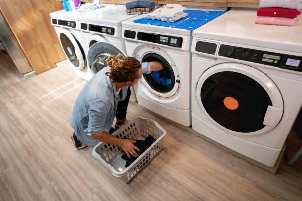 Top 60 Loading Washing Machine Stock Photos Pictures And Images