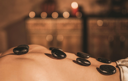 Unrecognizable Young Man On A Hot Stone Massage Therapy Stock Photo - Download Image Now - iStock