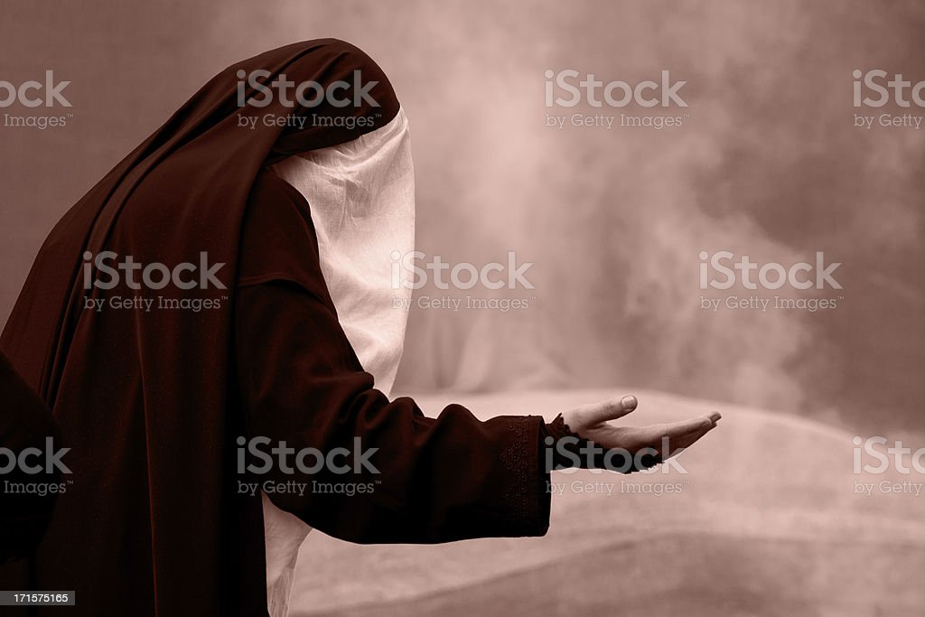 Unrecognized muslim woman praying stock photo