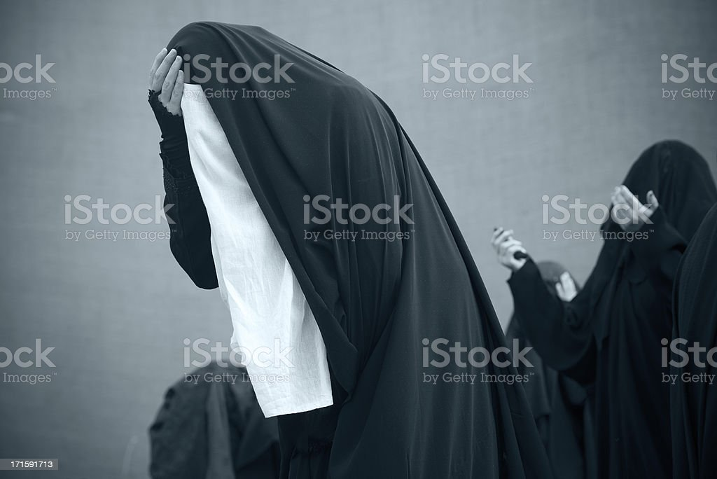 Unrecognized muslim women are crying royalty-free stock photo