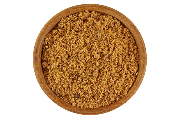 Unrefined unbleached natural Brown sugar in brown color stock photo