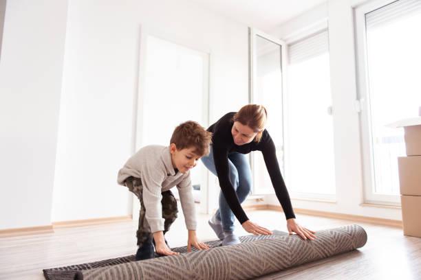 Unrolling the carpet stock photo