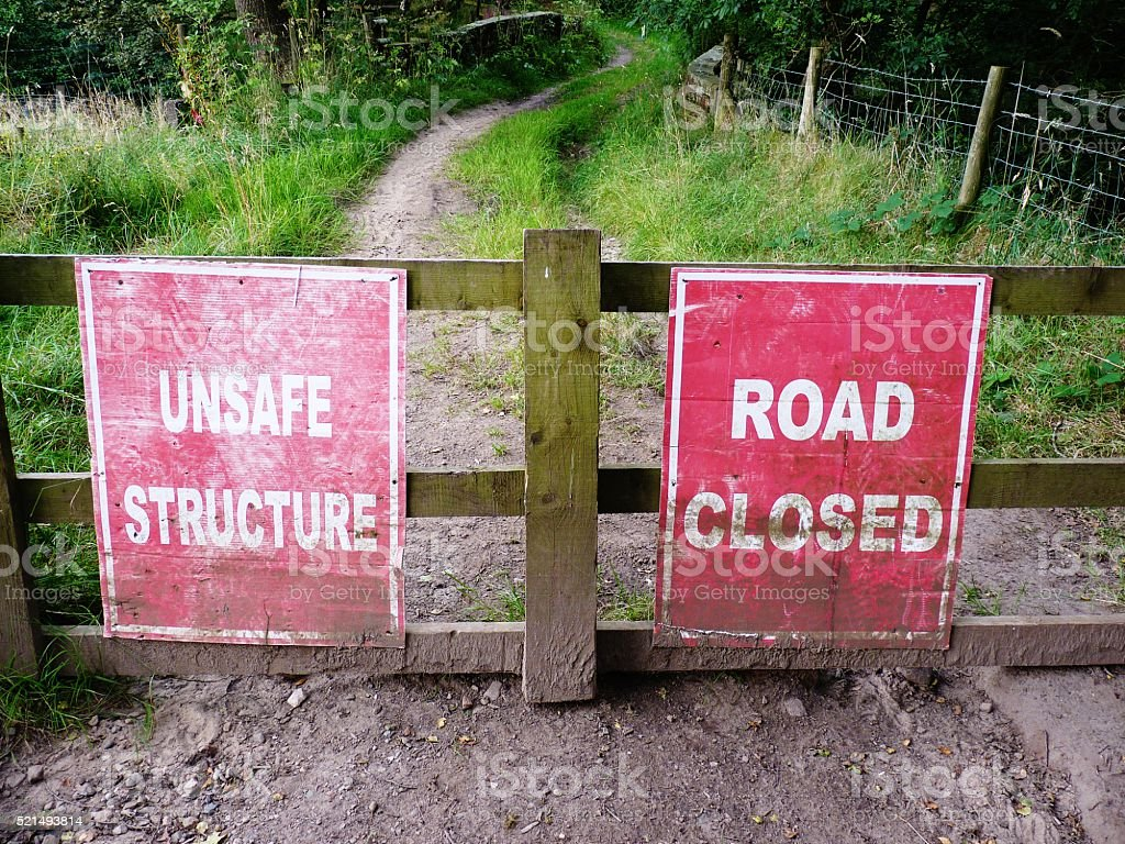 unsafe structure red and white sign stock photo