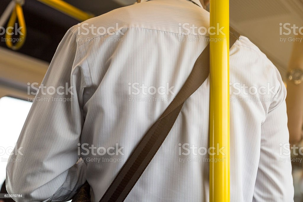 unsafety man lean on the pole in the train. stock photo