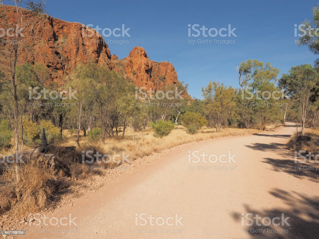 Unsealed access track of Trephina Gorge in the late afternoon sun, east MacDonnell ranges near Alice Springs, Northern Territory, Australia 2017 stock photo