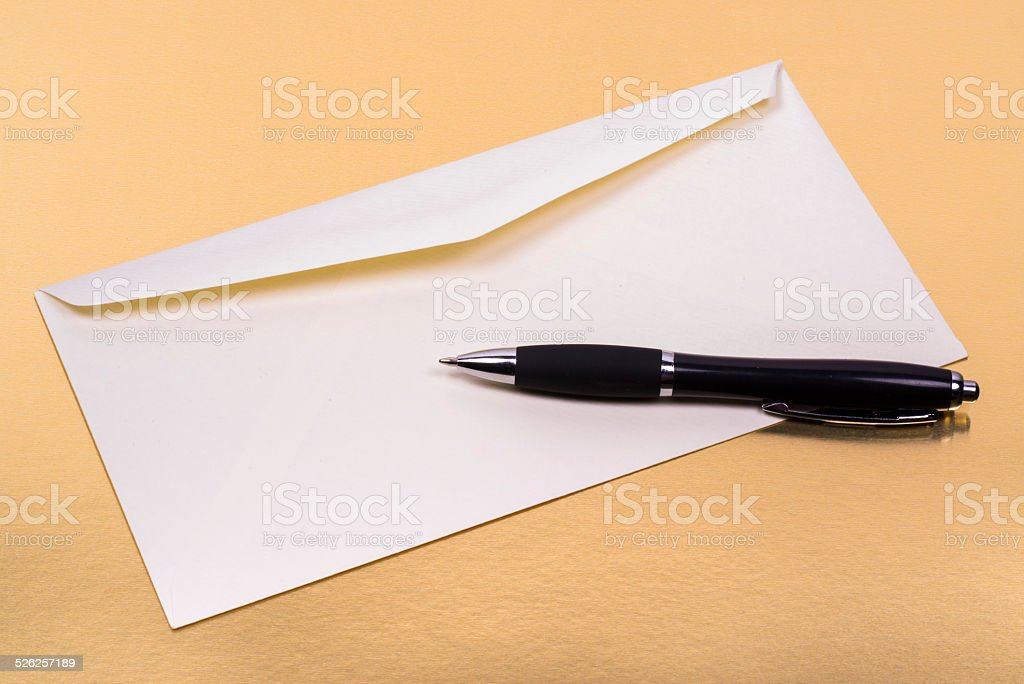 unsealed white envelope with a ballpoint pen on the side stock photo