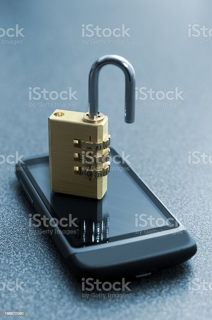 Unsecure Mobile Phone with an open lock royalty-free stock photo