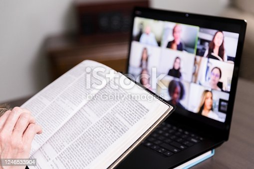 istock Unseen person joins Bible study through video conferencing 1246533904