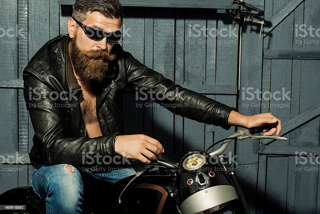 Unshaven male biker stock photo