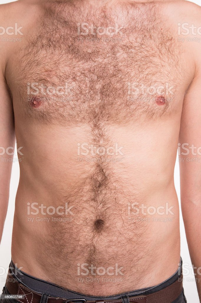 Unshaven man's chest and abdomen stock photo