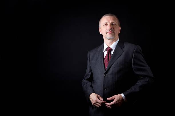 Unshaven mature businessman stock photo