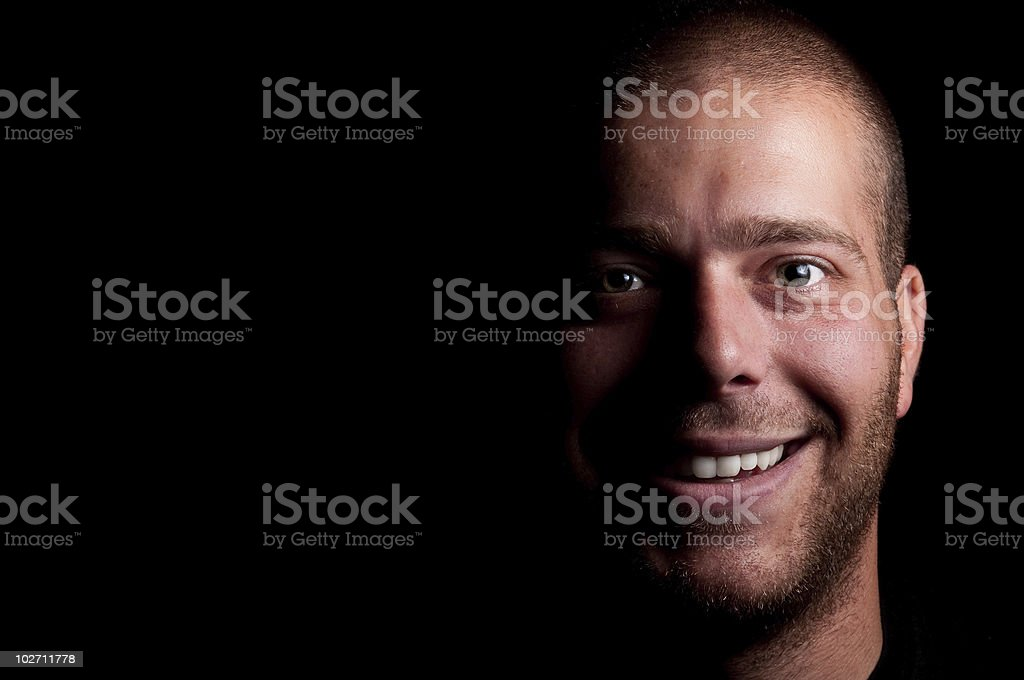 Unshaven smiling man with copy space. royalty-free stock photo