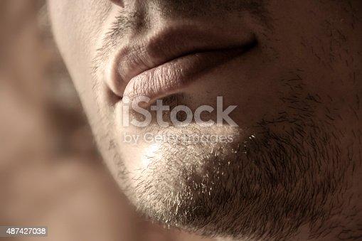 closeup unshaven chin of a young man