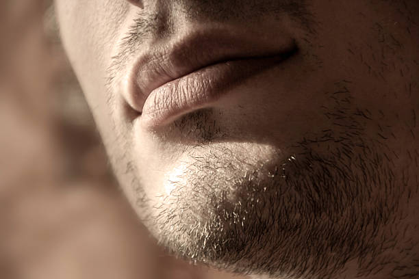 unshaven young man stock photo