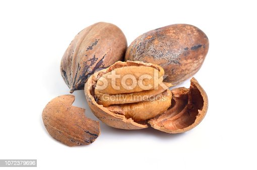 UnShelled pecan nuts isolated on white background